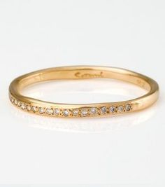 Catbird :: shop by category :: JEWELRY :: Wedding & Engagement :: Stoned :: Diamond Band can't find the (channel set?) one I like. This is not as nice and more organic looking.