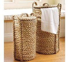 Wicker hampers, perfect for a beach inspired bathroom or laundry room.
