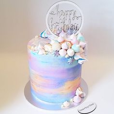 Sunday prettiness for a dear friend Layers of spiced banana cake, @heilalavanilla syrup and vanilla watercolour buttercream. With a custom whitewashed topper, mixed meringues, Rafaello, sprinkles and #birthdaycake #melbournecakes #melbournefood #melbournekids #acdn #acdnmember #onebyonecakes #meringues #meringue #rafaello #watercolourbuttercream #sprinkles #pastel #cake #instafood #buttercream #unicorns #rainbow #unicorncake #unicornparty