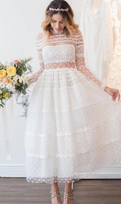 Sweet & oh-so twirl-worthy! The perfect rehearsal dinner dress or a fun alternative to the traditional long wedding gown!