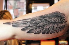 Wing Tattoo on the Upper Arm...its really good wing but I don't like where its placed right by the armpit like it looks like his armpit grew wings lol