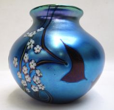 ORIENT & FLUME IRIDESCENT ART GLASS VASE having floral, heart and vine motif. Height 3.5 inches. Sold for $325 in January 2014.