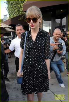 "Taylor Swift in a more understated ""heart  polka dot"" dress by Dolce & Gabbana.    http://nubry.com/2012/02/trend-alert-polka-dots/"