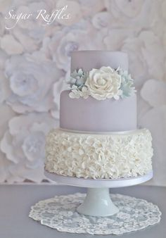 Dove Grey Wedding Cake...very pretty, maybe swap the grey with a peach color and put the flower between only 2 tiers, not 3. :)