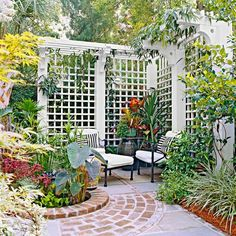 Open Shelter  With its wraparound form and projecting top, this trellis ensemble offers privacy in a delightful and relaxing setting. The sense of shelter is unmistakable, but the space doesn't feel too enclosed. A pair of cushioned chairs is the only invitation necessary.