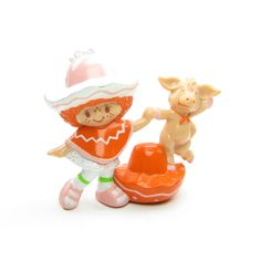 """This vintage Strawberry Shortcake miniature figurine is """"Cafe Ole Dancing with Burrito."""" It features Strawberry Shortcake's International Friend, Cafe Ole, dancing with her pet donkey, Burrito. It's o"""