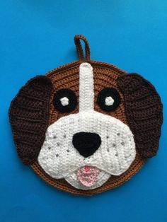 The pattern and tutorial I'll be showing you today is this crochet dog potholder. This was another request that I got. If you would like to follow along with the video tutorial, it's available at Crochet Dog Potholder Tutorial.