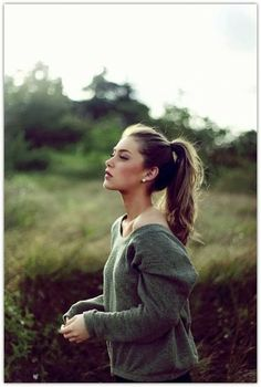 High Ponytail:   This is positioned correctly.  Notice how it flatters her cheek bones and jaw line.