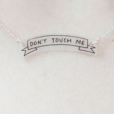 """Necklace with a small banner that reads """"DON'T TOUCH ME."""" Necklace charm is made of a lightweight durable plastic. Each necklace is. Danielle Victoria, Karin Uzumaki, Emma Carstairs, The Oa, Malia Tate, Cassandra Cain, Last Unicorn, Six Of Crows, Gekkan Shoujo"""
