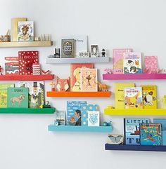 Perfect for adding color to kids' rooms: Show off books, artwork, and decorative objects on a trio of powder-coated-iron floating shelves in one of 10 snappy shades. 24-inch Color Bar Ledge, about $29; landofnod.com