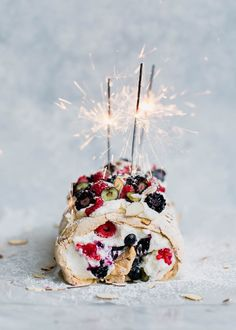 A Triple Berry Meringue Roulade perfect for summer nights. Easy to make and a total crowd-pleaser!