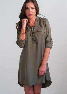On the Road Pikes utility dress; military green roll tab sleeve tie up neckline utility shirtdress featuring double chest pockets & hi/low hemline, utilitarian inspired shirtdress, olive green shirtdress, work to weekend shirtdress, easy layering dress, classic shirtdress, must have military style shirtdress for Fall 2016