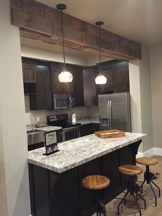 Diggin' this downstairs kitchenette. The beam is a cool touch