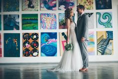 After the ceremony, grab your honey and head to our painting studio for some unforgettable photo opportunities at Artists For Humanity EpiCenter www.afhboston.org I Photo by Lorenz Photography www.abbylorenzphotography.com