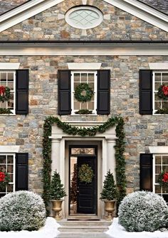 Amazingly realistic greenery, lush with berries, pinecones & clear or colored lights. Such a gorgeously festive front door and home!