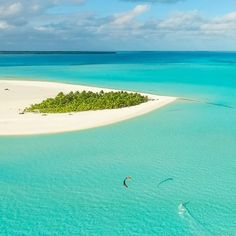 """Dreaming of a kitesurfing getaway .. Where would it be??"" - Honeymoon Island, Cook Islands is a good start #kitetravel #kitespots #kitesurfing #kiteboarding - ActionTripGuru.com"