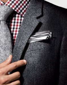 Love the grey on grey for suit, tie and square.  Then color in the shirt.  Maybe a larger pattern.  Gingham only if multi-color.