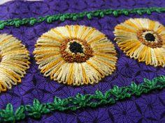 Original Design copywrite Alison Pembroke 2013 Embroidered cuff for teachers present.