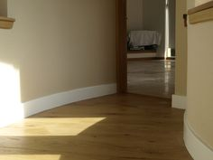 An excellent example of our skilled joiner showing exactly how to fit oak flooring to a curved corridor