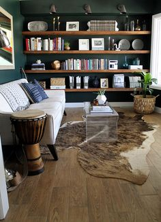 Shelving, open wooden shelves, cowhide rug                                                                                                                                                                                 More