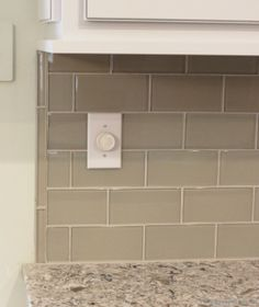 Pencil rail caps off the end of a #glass #subway #tile backsplash. | VillageHomeStores.com