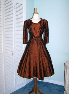 Why don't they make dresses like this anymore??>> Burnt Copper Metallic Silk Taffeta Embossed Embroidery-Stunning Vintage 1940s/ early 50s Full Sweep Dress. $145 on Etsy.