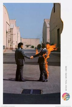 """A great poster of the classic album cover from the Pink Floyd LP Wish You Were Here! Fully licensed. Ships fast. 24x36 inches. Take some """"Time"""" to check out the rest of our amazing selection of Pink F"""