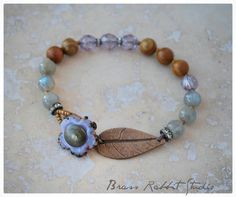Boho stacking bracelet with sweet artisan lampwork flower button and handmade bronze leaf connector, pairs with Labradorite rounds (high flash), woodgrain jasper, and silver accented lavender Czech crystals.