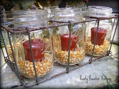 votives in dried corn  Beautiful for fall decor.