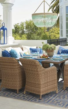 Bowing gently backward like O'Keefe's calla lilies, our handwoven Beaumont Dining Set sighs with the grace of relaxed outdoor dining. | Frontgate: Live Beautifully Outdoors