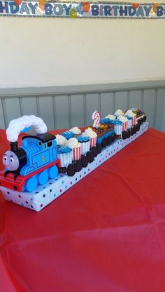 My Thomas the train cake - chocolate mudcake cupcakes, vanilla cupcakes with caramel slice underneath them. Madeira cake with skittles and m&m's + oreo cookies for the wheels.