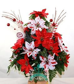 Beautiful XL Red and Peppermint Poinsettia's With Candy Canes Deco Mesh 3 Inch Cemetery Vase. This Beautiful XL Red and Peppermint Poinsettia's With Candy Canes Deco Mesh 3 Inch Cemetery Vase will last up to 5 months in full sunlight. The Vases fit the standard 3 inch vase and measure 24 inches high and 15 inches wide. Crazyboutdeco arrangements are made with top shelf high quality silk flowers and greenery and are built to last. The Headstone Saddle frames can be adjusted to fit any size...