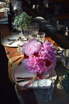 Peony and Rose Boquet with the table setting for a mountain wedding