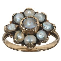 "An 18th Century Natural Pearl Gold Fede Ring. The term ""fede chianina"", used to describe traditional family ring that Aretinian mothers-in-law used to give to their daughters-in-law, as a symbolic inheritance from woman to woman. It was quite coarse, but that's precisely why it was so precious: its corolla of eight natural pearls around a larger natural pearl. This ring ispired family stability, c 1790"