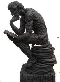 'Le Poete'  - made from old bicycle tyres         - - by Mick Davis