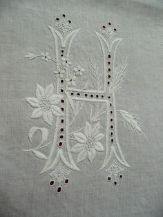 Handmade linen shams fancy H monogram c1800s.  If this was a dresser scarf, it would be so cool to make a throw pillow.  I did this with another dresser scarf that had spots in the center but a marvelous embroidery on each end and it made a terrific throw pillow.