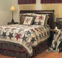 Master Bedroom 1: Antique Americana  This comfortable Stars of America Quilt from CountryStyleHome brings rich notes of tan, blue and burgundy to the room.