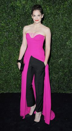 Actress Ruth Wilson sported an ensemble from Christian Dior Couture collection consisting of black cropped trousers and a hot pink strapless dress slit at the front. A glam way to rock the skirt over pants trend.