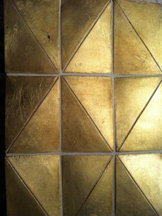 No info on these excellent golden triangular tiles. Would love to know who's behind them.