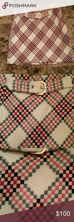 """Juicy Couture plaid wool Skirt  Valentines Day ♡ Juicy Couture red plaid wool Skirt size 4. Perfect for Valentines. White, black and multi shades of red. EUC.   Built in front belt, inside red lining 100% silk and zip up on left side. Approximately 17"""" long Juicy Couture Skirts Mini"""