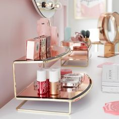 Stash and display pretty things on this Gorgeous Beauty Organizer. A gold stand and mirrored rose gold trays add a sleek, chic look atop your vanity. Our collaboration with Benefit Cosmetics brings the bold beauty brand's glam style to your …