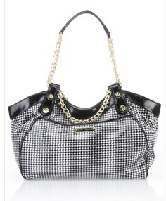 """Fiesta Satchel In Houndstooth    Betsey Johnson has danced to the rhythm of her own drum for nearly three decades, and her designs reflect an exuberance that is truly Betsey  • Features chain link flat handles  • Zippered outer pocket  • Snap button closure at main pocket  • Inner drop pocket and zippered pocket   Approximate Measurements: 17"""" L x 11.5"""" W x 5"""" D   Measurements Taken From Size: One Size   Color: Hounds tooth   Composition: 100% PVC   Origin: China"""