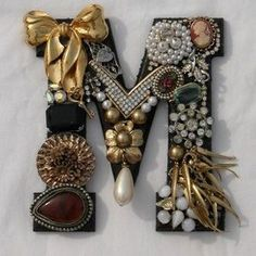 to do with broken jewelry? DIY: Costume jewelry monogram initial - great use for broken jewelry or orphaned earrings.DIY: Costume jewelry monogram initial - great use for broken jewelry or orphaned earrings. Vintage Jewelry Crafts, Vintage Costume Jewelry, Vintage Costumes, Jewelry Art, Jewelry Ideas, Fashion Jewelry, Costume Jewelry Crafts, Recycled Jewelry, Silver Jewelry