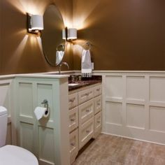 Judges paneling in the basement bathroom gives this bath a special touch. By CRS.