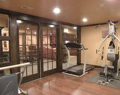 French doors/windows out to basement. Might be smart to position gym/treadmill so that we could watch large tv instead of buying smaller tv.