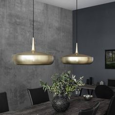 The stunning design of this contemporary pendant lampshade makes it really special. With its smooth yet elegant lines, a graceful silhouette and raw metallic finish, the small symmetrical holes around the lampshade gently diffuse an ambient glow which lights up the surrounding areas with dancing dots. Finished in a beautiful brushed brass which is so on-trend at the moment, this gorgeous shade was originally designed to be placed over a dining table but we think it will look good in any…