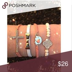 """Bracelet Arm Candy Stack Peach Love Elephant Cross 1. A peach embroidery braided bracelet with a sparkling rhinestone cross. Adjustable pull style closure.  2. A white leather vinyl skinny bracelet with a gold bow. Approx. 7"""" long with magnetic closure.  3. A peach embroidery braided bracelet with a small gold elephant with a peach enamel heart on its body. Approx 9"""" long with 2"""" size extension. Lobster clasp closure.   4. A white beaded stretch bracelet with sparkling rhinestone clover…"""