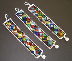 The process of making an item out of Zulu beads is to take a piece of string as long as you want your item to be. Then you would take a sewing needle and put the string through it, then place the… African Beads, African Jewelry, African Accessories, Zulu, Bead Loom Patterns, Beading Patterns, Tribal Patterns, African Theme, Beaded Jewelry