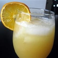This version of sangria features frozen peaches and pineapple juice with peach schnapps and white wine for a refreshing summertime adult beverage.