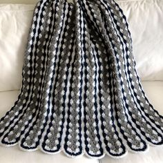 This mile a minute styled blanket is crocheted in several long, skinny strips that are then sewn together. Here is the link to the free pattern!  http://www.knitting-crochet.com/found/mamfou.html